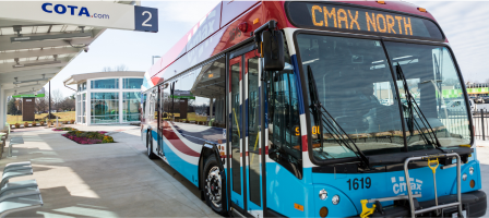 A COTA C-Max bus stopped at a transit center.